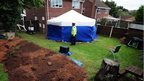 Police officer at a garden in Forest Town after remains were found