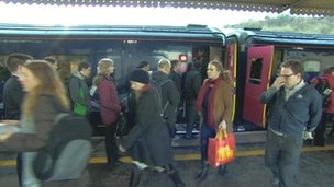 Commuters exit a First Great Western train
