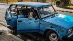 A man rests in a car front the Moncada Barracks in Santiago de Cuba, on July 23, 2013