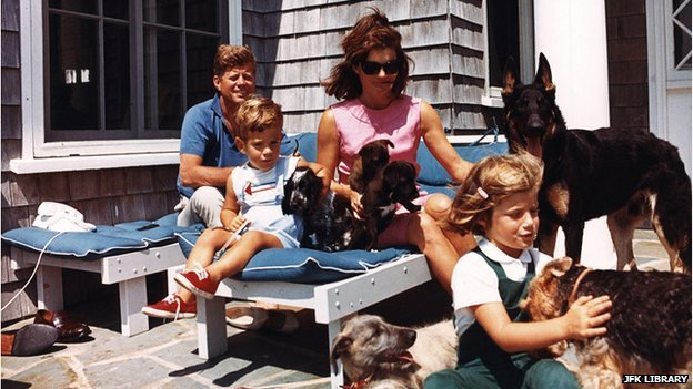 The Kennedy family with dogs, including two of Pushinka's puppies and Charlie