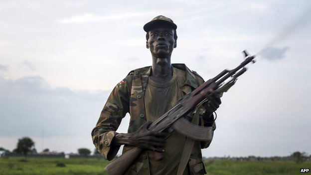 Nuer tribesman holding rifle
