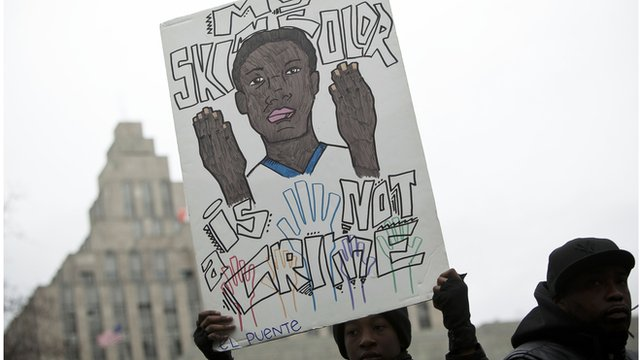 Protestor hold sign against stop-and-frisk policy