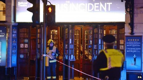 Fireman stands outside Apollo theatre