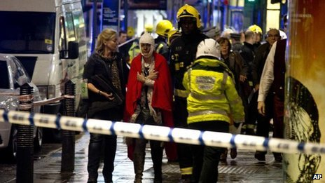 Woman bandaged at Apollo Theatre after ceiling collapse
