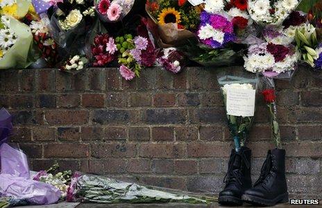 Floral tributes and a pair of Army boots left at the scene of Fusilier Lee Rigby's killing