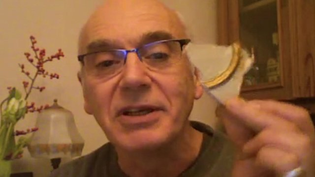 Theatre-goer Chris Edwards shows a piece of fallen plaster