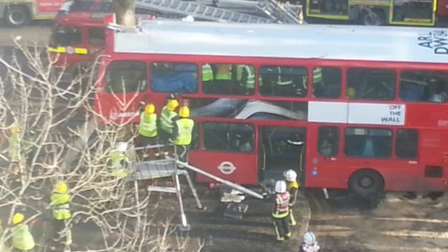 Rescuers working at scene of London bus crash