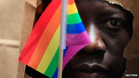 An asylum seeker from Uganda covers his face with a paper bag in order to protect his identity as he marches with the LGBT Asylum Support Task Force during the Gay Pride Parade in Boston, Massachusetts June 8, 2013.