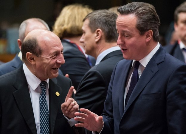 UK Prime Minister David Cameron (right) talking to Romanian President Traian Basescu in Brussels, 20 December