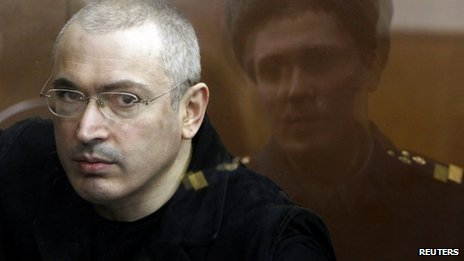"Jailed Russian former oil tycoon Mikhail Khodorkovsky is seen standing in the defendants"" cage during a court session in Moscow in this April 5, 2010 file photograph."
