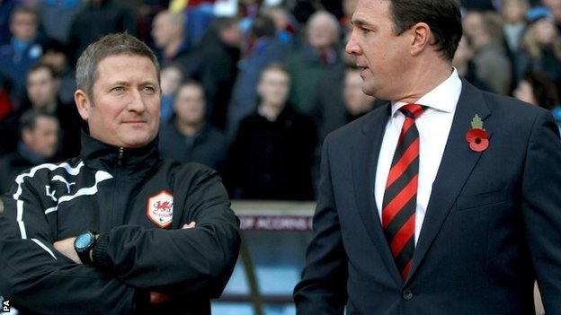 Cardiff assistant manager David Kerslake and boss Malky Mackay