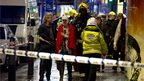 Injured woman led away by emergency services