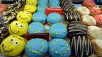 Doughnuts bearing the colours of the European flag are on sale in a pastry shop in Kiev