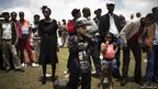 South African people watch from a hill the state funeral of South African President Nelson Mandela in Qunu