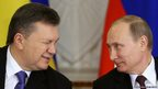 Ukrainian President Viktor  Yanukovych (left) gives a wink to his Russian counterpart Vladimir Putin