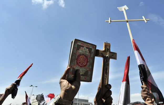 Protesters hold crosses and Koran in demonstrations against sectarianism in Cairo, 2011