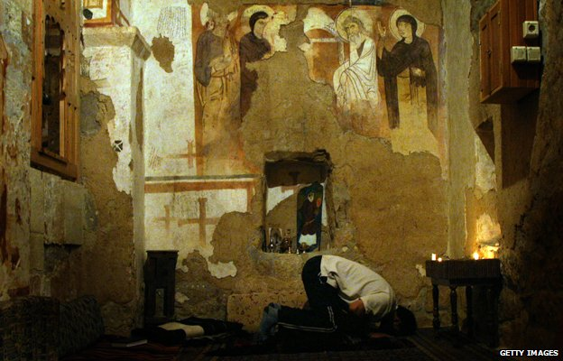 Muslim man prays in Monastery of St. Moses the Abyssinian, east of Nebek, Syria