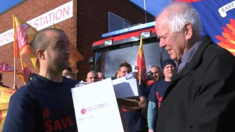 Chris Tapp from the Fire Brigades Union handing the petition over to fire authority chairman Roland Hosker on Friday