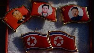 North Korean badges on sale in Dandong