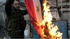Rebel fighter burns Syrian flag (21 Nov 2013)