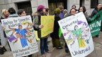 A group supporting domestic workers' rights protests outside the Indian consulate in New York
