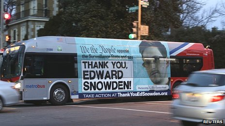 But bearing poster in support of Edward Snowden