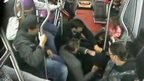 CCTV shows passengers holding thief on bus floor