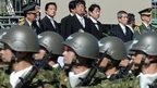 Japanese Prime Minister Shinzo Abe (top ) inspects Self-Defence Force. 17 Dec 2013