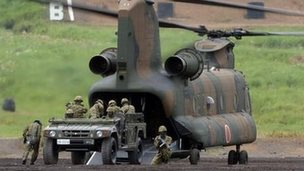 Picture taken on August 20, 2013 shows Japanese Ground Self-Defense Forces vehicle being unloaded from a CH47J transport helicopter during an annual live fire exercise at the Higashi-Fuji firing range in Gotemba,