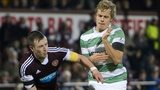 Hearts captain Danny Wilson and Celtic's Teemu Pukki