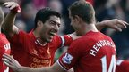 Liverpool striker Luis Suarez (left) and team-mate Jordon Henderson celebrate during the win over Cardiff