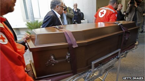 Members of the Lebanese Red Cross carry the coffin of Abbas Khan