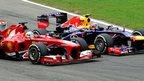 Ferrari's Fernando Alonso passes Red Bull Racing's Mark Webber during the Italian Grand Prix at Monza