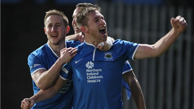 Linfield's Michael Carvill celebrates with goal-scorer Mark McAllister