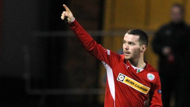 Cliftonville goal-scorer Martin Donelly acknowledges the crowd at Solitude