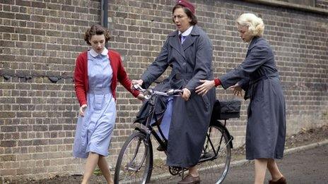 Miranda Hart rides a bicycle in the TV programme Call the Midwife