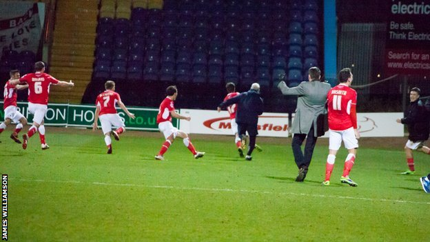 Accrington's players celebrate their late winner against Mansfield