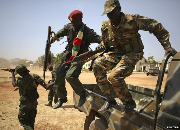 SPLA soldiers leap from a pick-up truck in Juba, 21 December