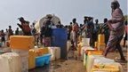 South Sudanese women queue for water at UN compound in Juba - 21 December
