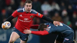 Munster fly-half JJ Hanrahan tries to get past Adam Warren at Musgrave Park
