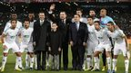 Moroccan King Mohammed VI poses with the team of Raja Casablanca prior to the final of the Fifa Club World Cup between Bayern Munich and Raja Casablanca in Marrakech