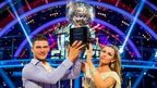 Aljaz Skorjanec and Abbey Clancy hold the Strictly Come Dancing glitterball trophy
