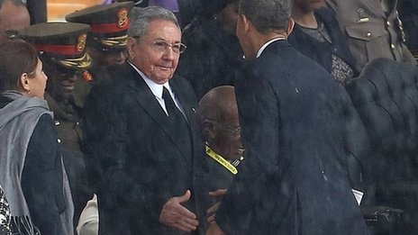 Raul Castro shakes Obama's hand, 10 Dec 13, Mandela memorial