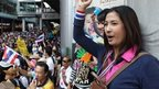 Thai office workers chant slogans during an anti-government rally on 20 December