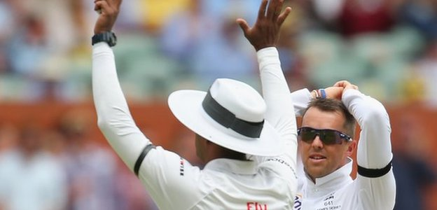 England spinner Graeme Swann looks dejected as Australia hit him for six