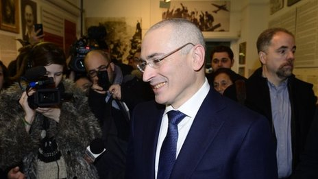 Former Russian oil tycoon and Kremlin critic Mikhail Khodorkovsky arrives at the Wall Museum in Berlin on December 22, 2013
