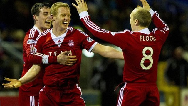 The Aberdeen players celebrate