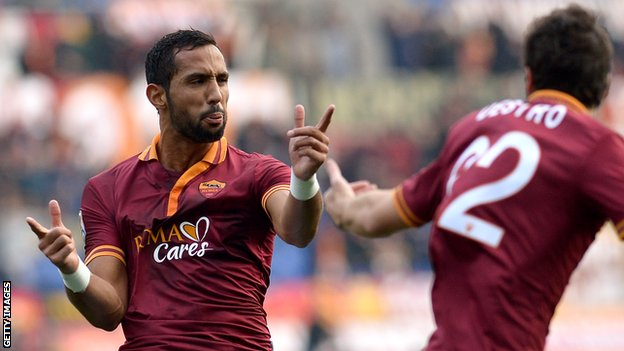 Roma's Mehdi Benatia celebrates scoring against Catania