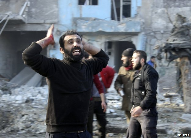 A man reacts in Aleppo's Hanano district after the bombing, 22 December