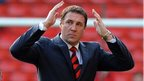 Malky Mackay acknowledges Cardiff fans at Anfield where his side face Liverpool in the Premier League on Saturday